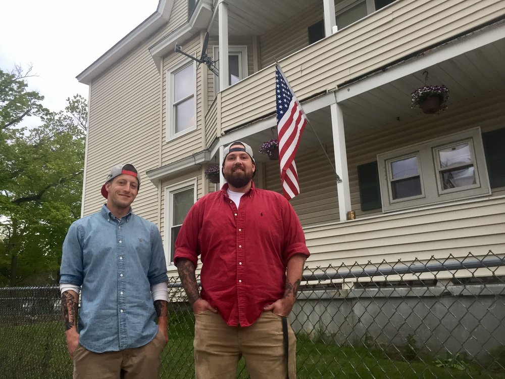 Erik Peterson (right) and Travis Statler (left) are house managers at Richie's Recovery in Manchester.   PAIGE SUTHERLAND/NHPR