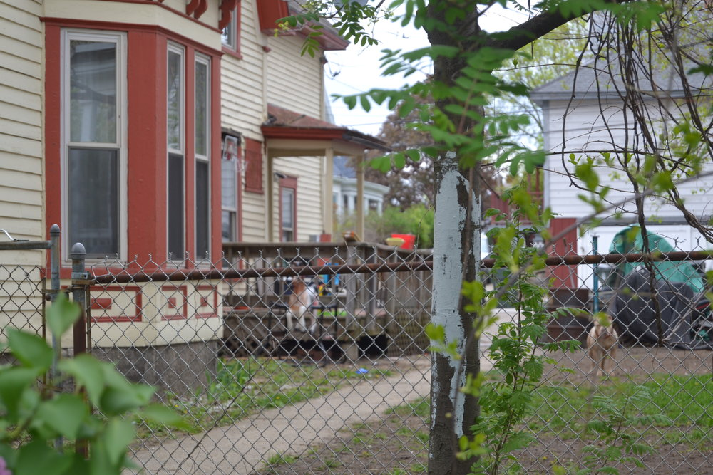"A side-view of the same house that firefighters suspect is operating as a ""recovery house.""   CREDIT PAIGE SUTHERLAND/NHPR"