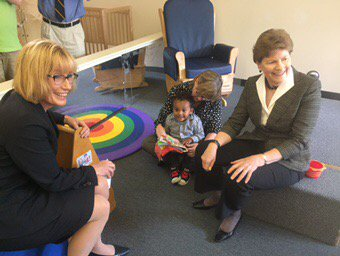 Senators Maggie Hassan and Jeanne Shaheen play with one of the kids in Manchester's Head Start Program on Friday  PAIGE SUTHERLAND/NHPR