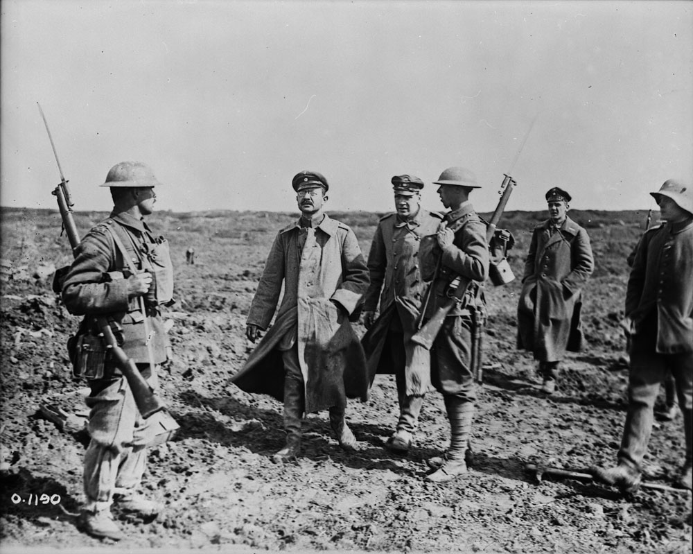 Title: Bringing in German officers – Vimy Ridge, April 1917.  Date: Between April 9 to 14, 1917  Credit:   Photo courtesy of Library and Archives Canada