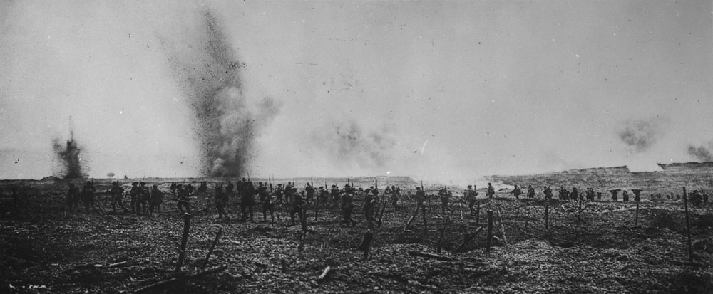 Title: Canadians advancing through German wire entanglements – Vimy Ridge, April 1917.  Date:  Between April 9 to 14, 1917  Credit: Photo courtesy of Library and Archives Canada