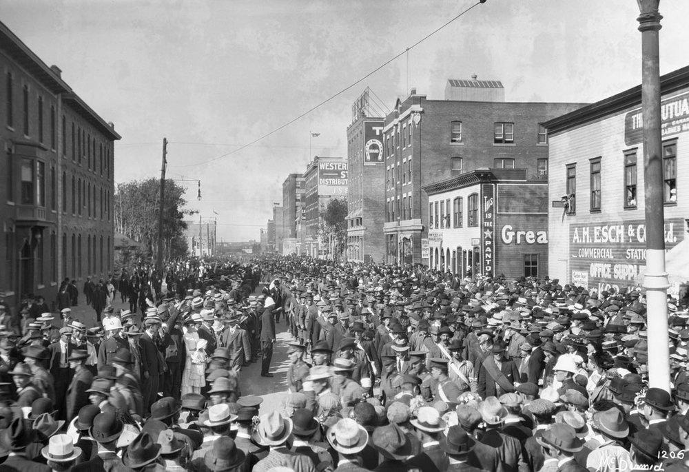 Image No: Glenbow Archives NC-6-1206 Title: 101st Battalion marching on 104th Street on leaving Edmonton, Alberta. Date: 1914 Photographer/Illustrator: McDermid Studio, Edmonton, Alberta