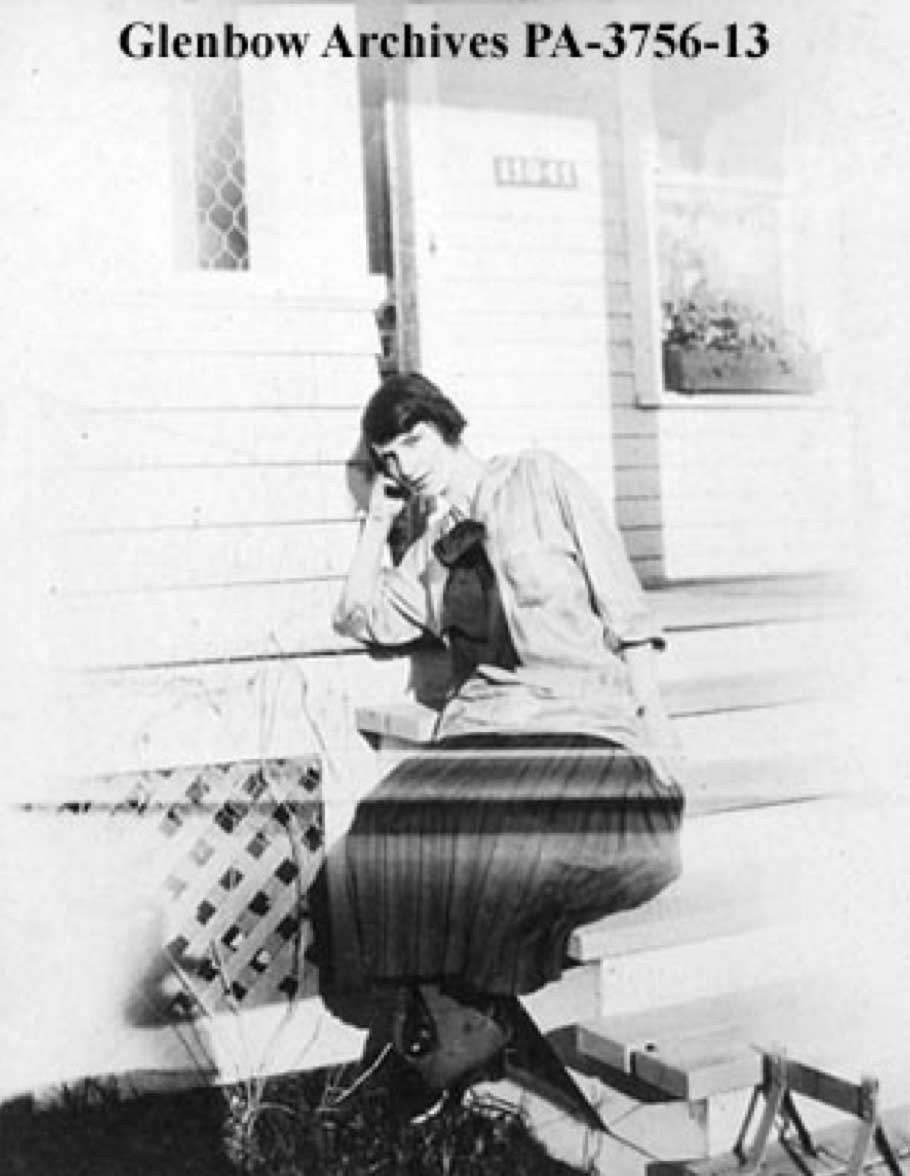 Cassie McKee in front of her home, ca 1916-1917, Photographer: Unknown, Glenbow Archives PA-3756-13
