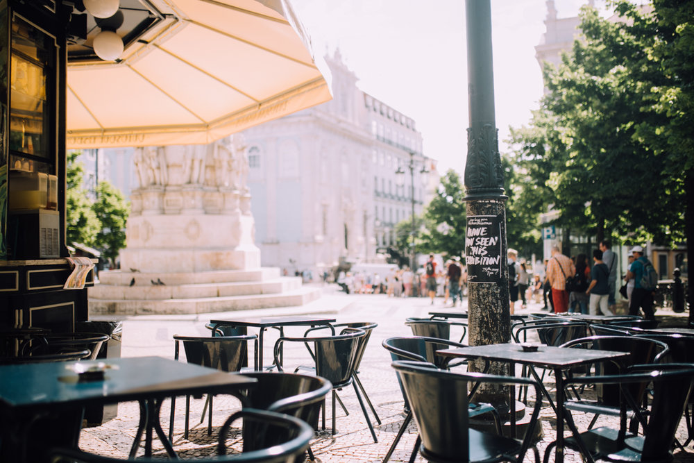 morning coffee and pastries in  Praca Luis de Camoes  in the heart of Lisbon