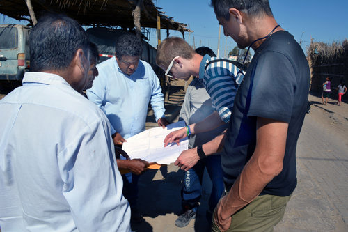 Consider becoming a Global Impact Volunteer . Executive Director Jacob Niemeier and VAVV Board Member Alberto Montoya (on right) go over plans with a team of consultants in Monte Castillo discussing the need to assess the sanitary sewer system.