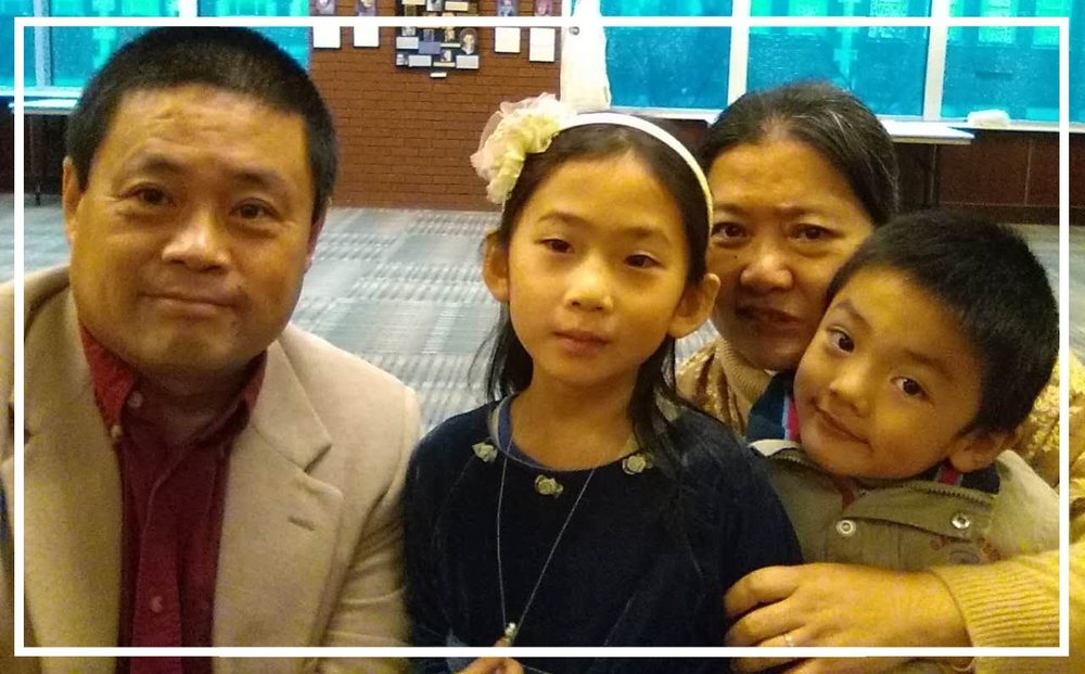Pastor Matthias, daughter Annie, wife Huifang and son Elijah