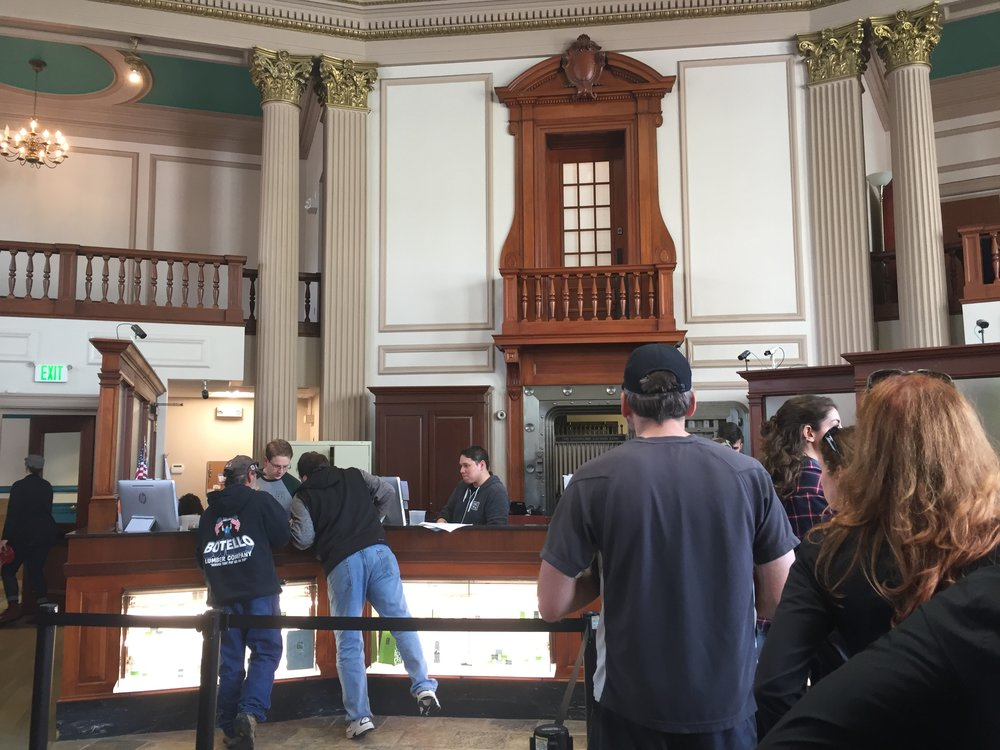 "Customers in line to consult with ""bud-tenders"" at the NETA medical marijuana dispensary in Brookline, Mass. in May, 2016. The dispensary, the busiest in the Boston area, is housed in a former bank."