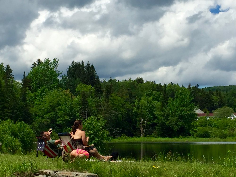 A family relaxes in the mountains near Bennington, Vermont.
