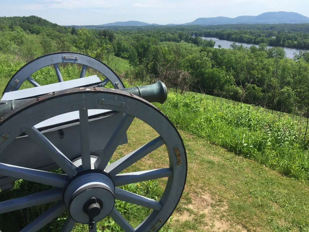 A cannon looks out over the Hudson River Valley at the Saratoga battlefield.