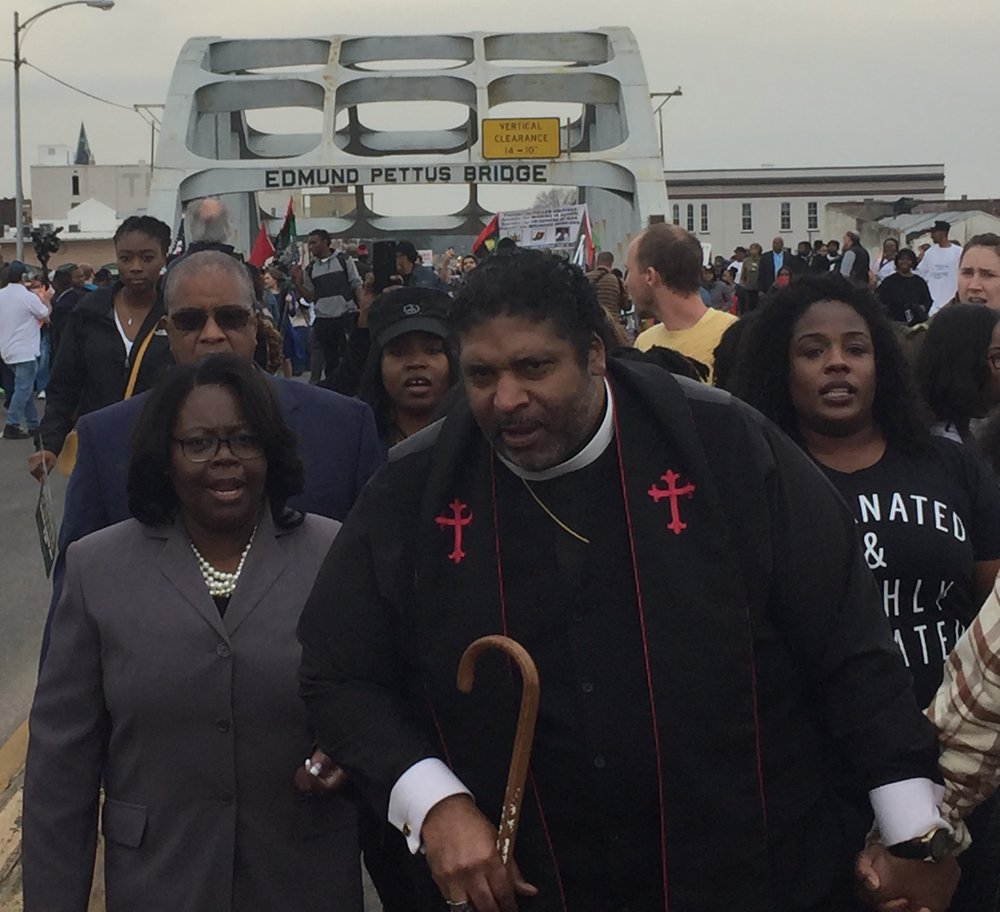 Taking it to the streets: Crossing the infamous Edmund Pettis Bridge in Selma, Ala., last March.