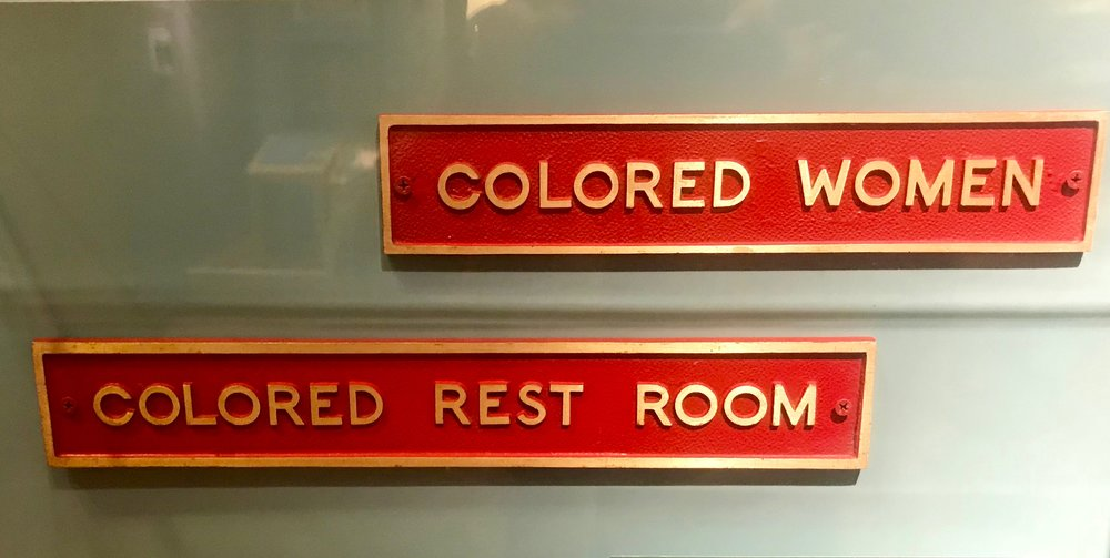 Jim Crow-era signs that hung in Plains, Ga., for the first 40 years of Carter's life.
