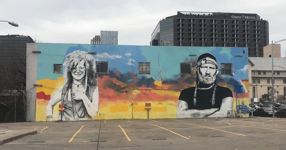Janis Joplin and Willie Nelson, two Austin icons, keep watch over a downtown parking lot.