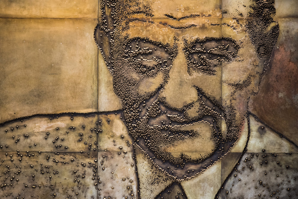 President Lyndon B. Johnson, depicted on a wall at the LBJ Library and Museum in Austin, Texas.
