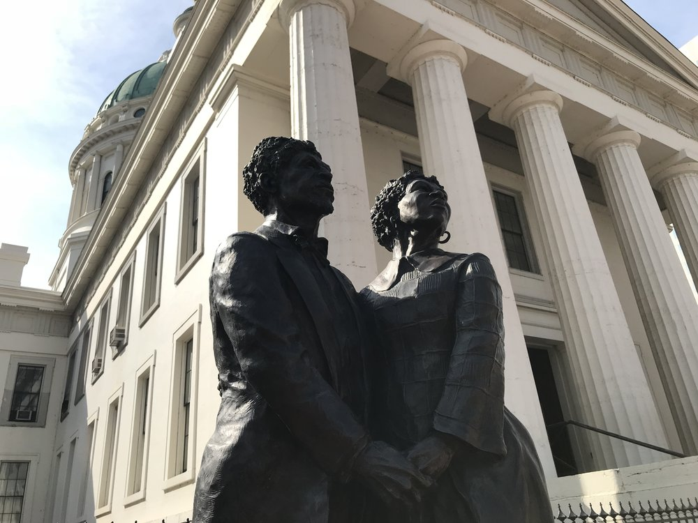 Dred Scott and his wife, portrayed in front of the St. Louis courthouse where he challenged his status as a slave.