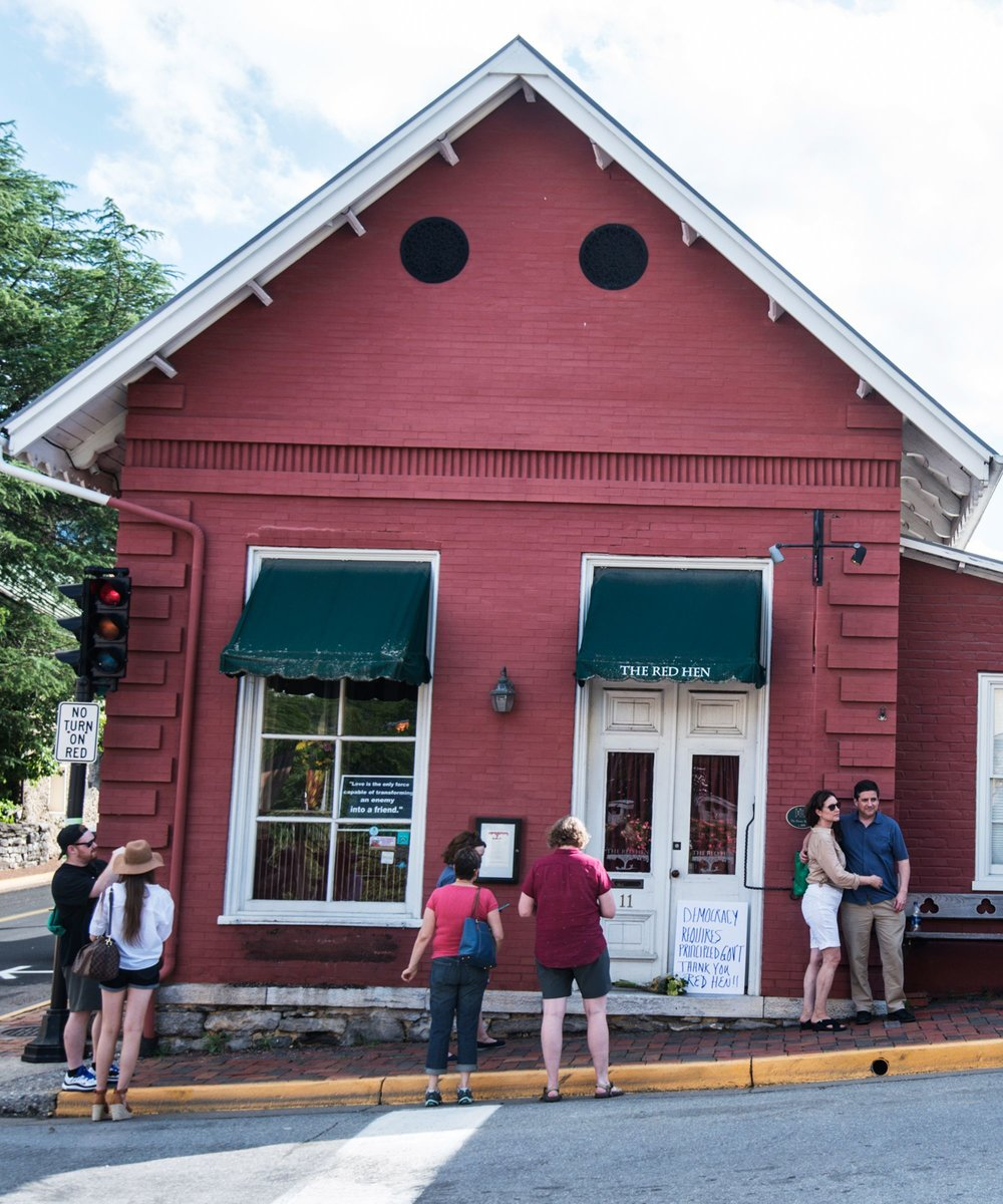 Demonstrators and tourists outside the Red Hen. AP Photo.