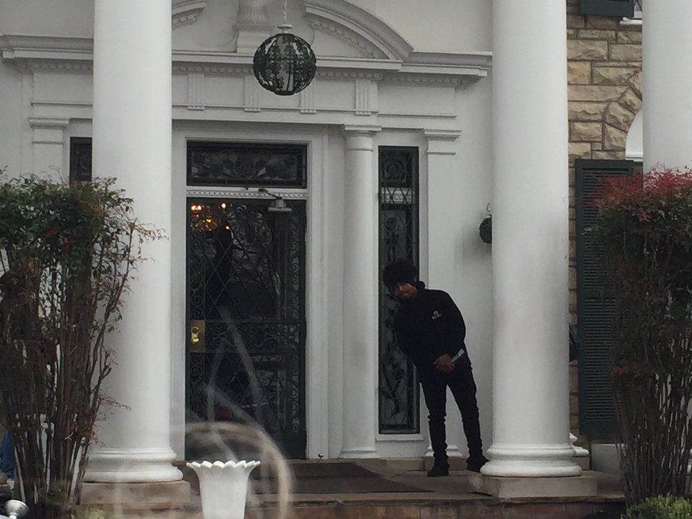 A tour guide at Graceland's front door awaits the next busload of visitors.