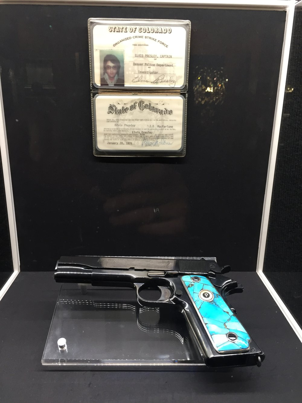 Elvis' handgun, along with his honorary membership in Colorado's Organized Crime Strike Force.