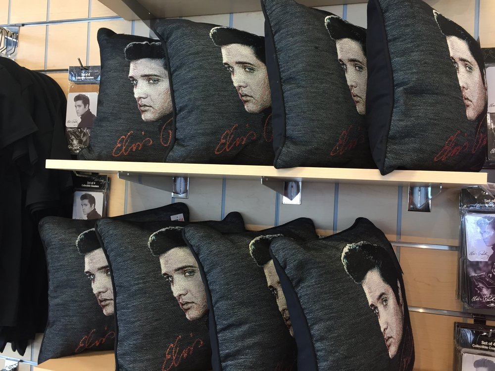 Souvenirs for sale at Graceland include all manner of images of Elvis, including these pillows.