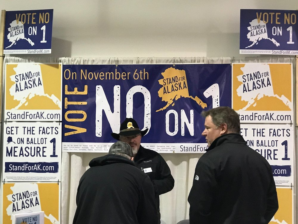 "Opponents of the ""Stand for Salmon"" initiative lobby visitors to the Alaska State Fair."