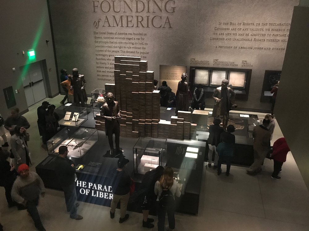 Visitors look over some of the history exhibits at the National Museum of African American History and Culture.