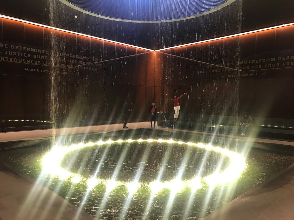 An indoor waterfalls provides a contemplative spot inside the National Museum of African American History and Culture.