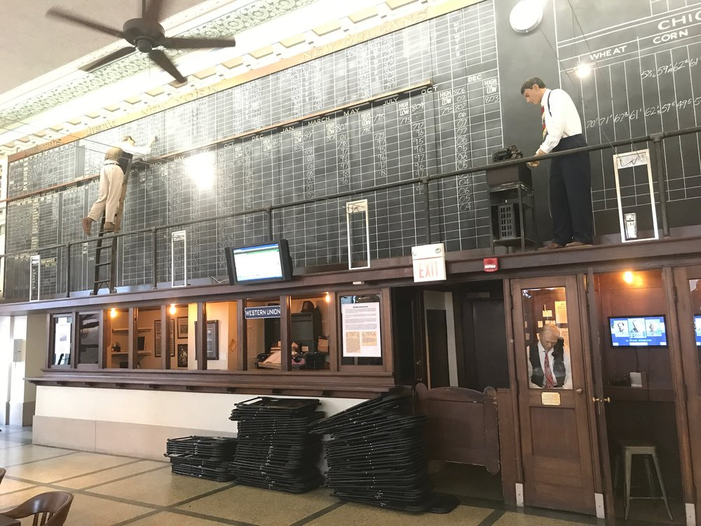 Computers have replaced the chalkboard on which trades were posted at the Memphis Cotton Exchange.