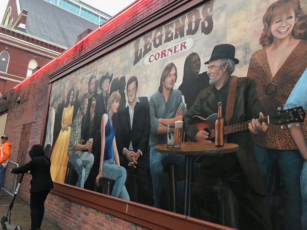 A mural of country music legends outside a bar on Broadway in Nashville