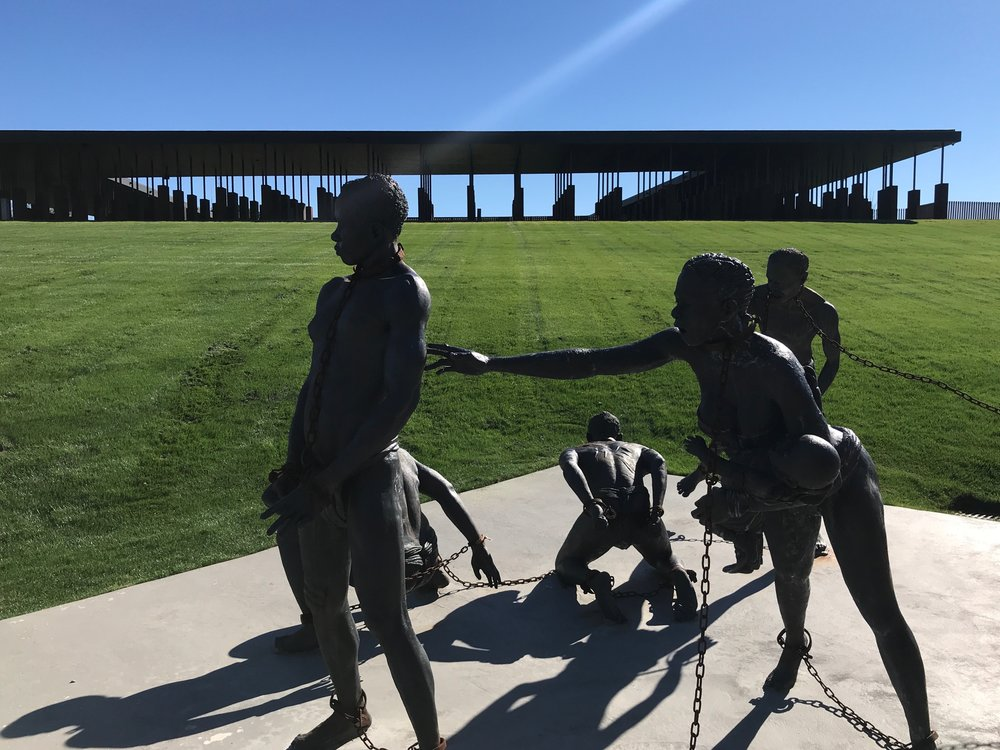 A sculpture depicting slavery stands on the grounds of the National Memorial for Peace and Justice in Montgomery, Alabama.