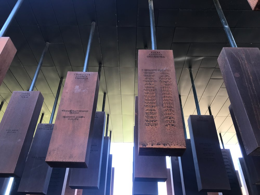 Iron slabs engraved with the names of thousands of lynching victims make up the centerpiece of the National Memorial for Peace and Justice in Montgomery, Ala.