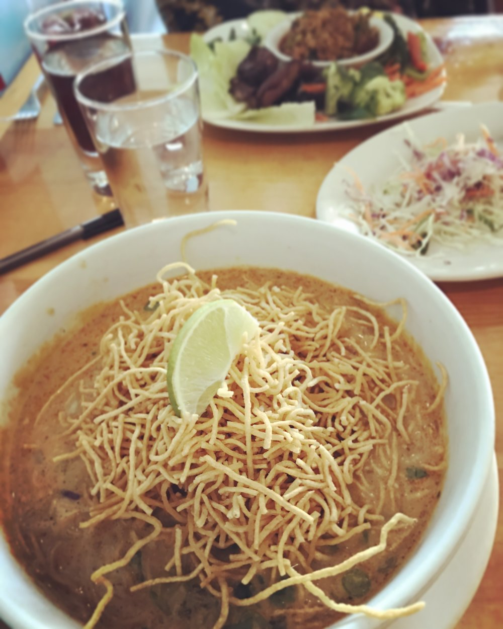 Khao Soi: Curried Chiang Mai egg noodle dish with beef, cilantro, pickled mustard greens and shallots.
