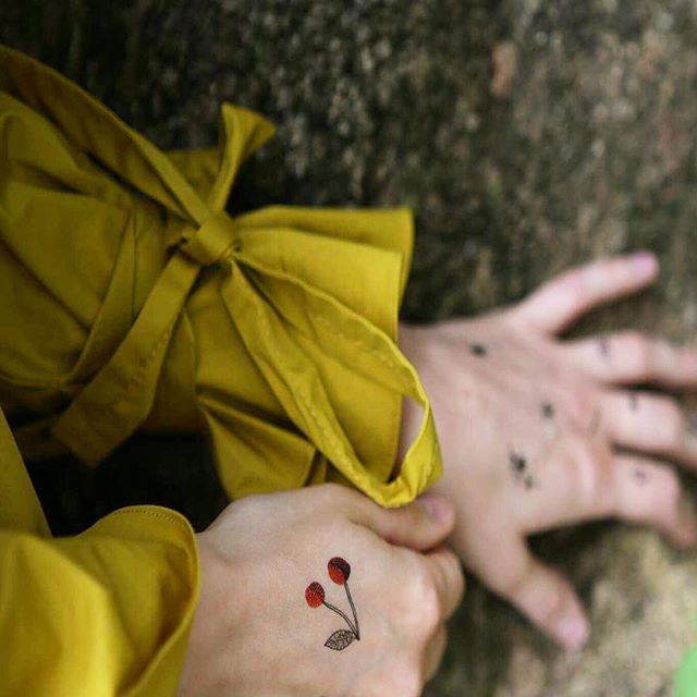 Spring comes with yellow. #temporarytattoo #yellow #tattoo #trend #cherry #musttry #newzealand #blogger #fashionblogger #photography #dress #nature #newzeland