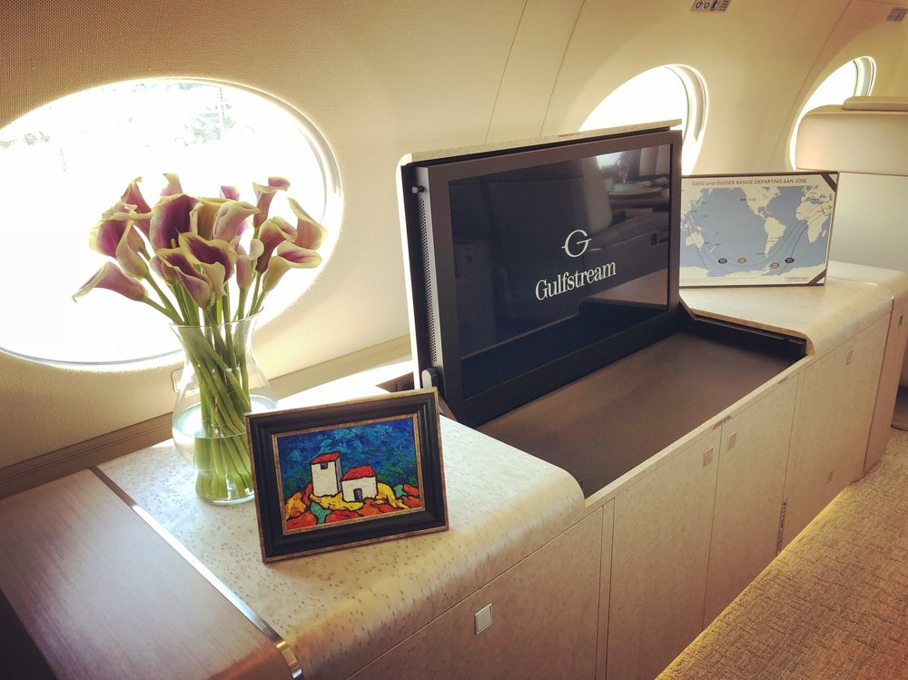 Doesn't this original Eric Bodtker painting add a great splash of color to the credenza on the Gulfstream G650 ER?