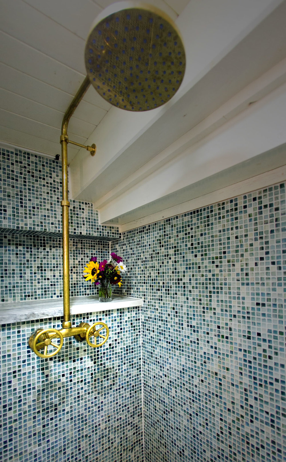 Showers are outfitted with rainshower heads. Photo: Nadra Edgerley