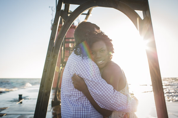 couple hugging on pier, connection, embrace, warmth
