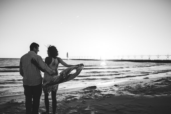 couple dancing on beach with scarf creating beautiful movement, black and white