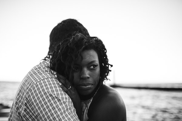 Intimate portrait of couple on beach, black and white, connection, raw, powerful