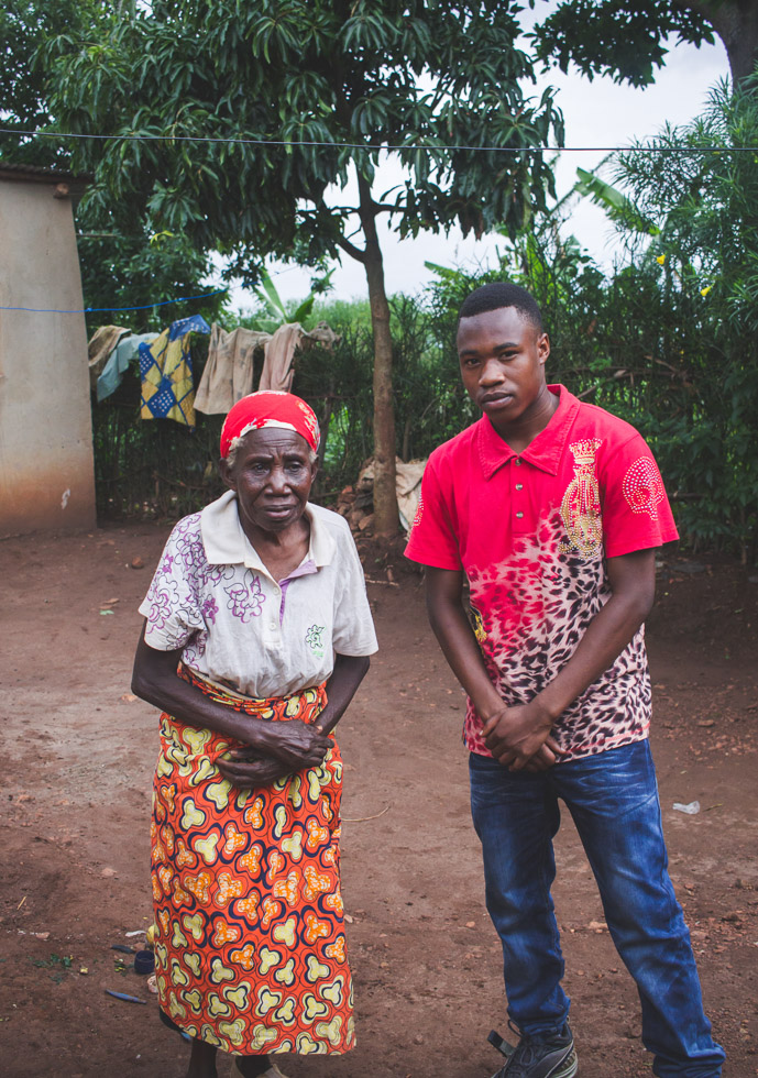 Portrait of grandmother with grandson outside home Africa