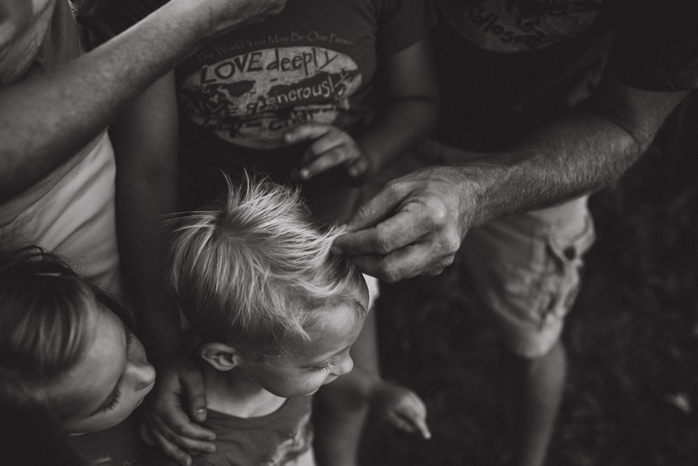father stroking fingers through his sons hair, connection, love, black and white