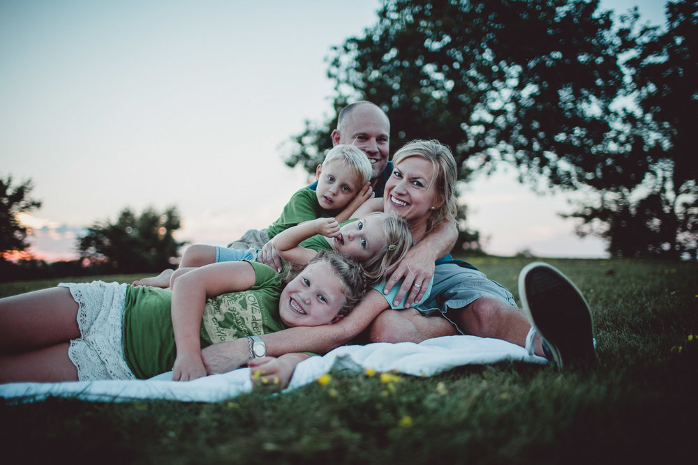 family portrait on blanket in field