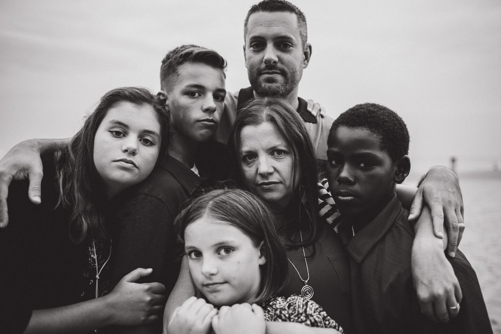 a serious portrait of a family woven together