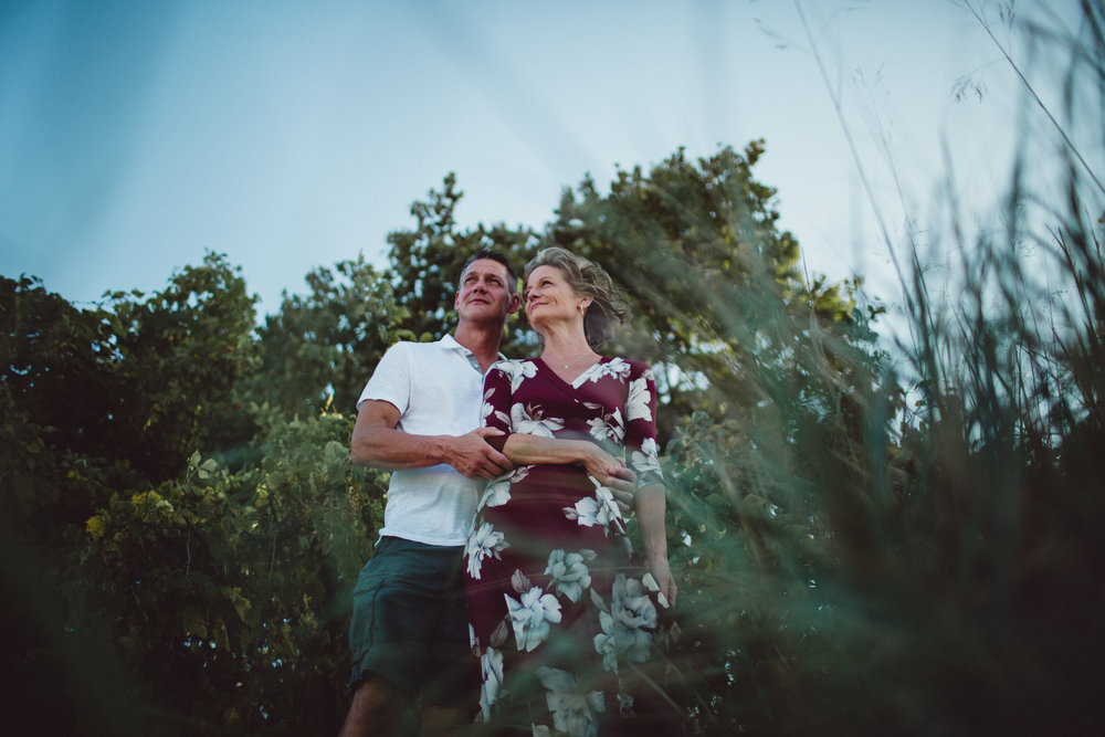 Layered image of couple shot through bushes