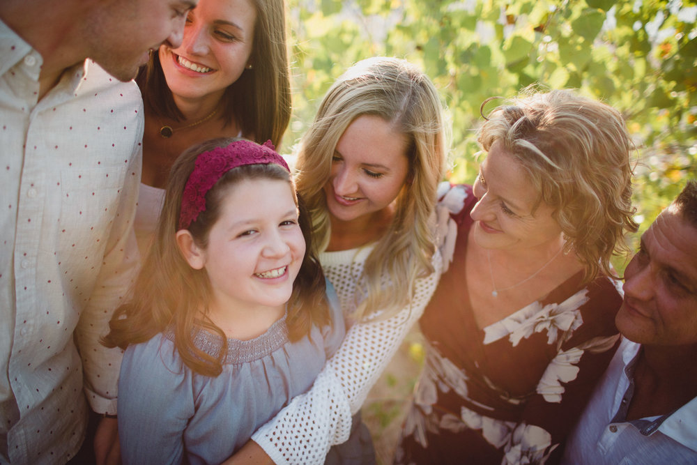 overhead shot of family laughing together in gorgeous light