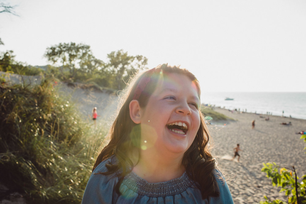 girl laughing in beautiful light