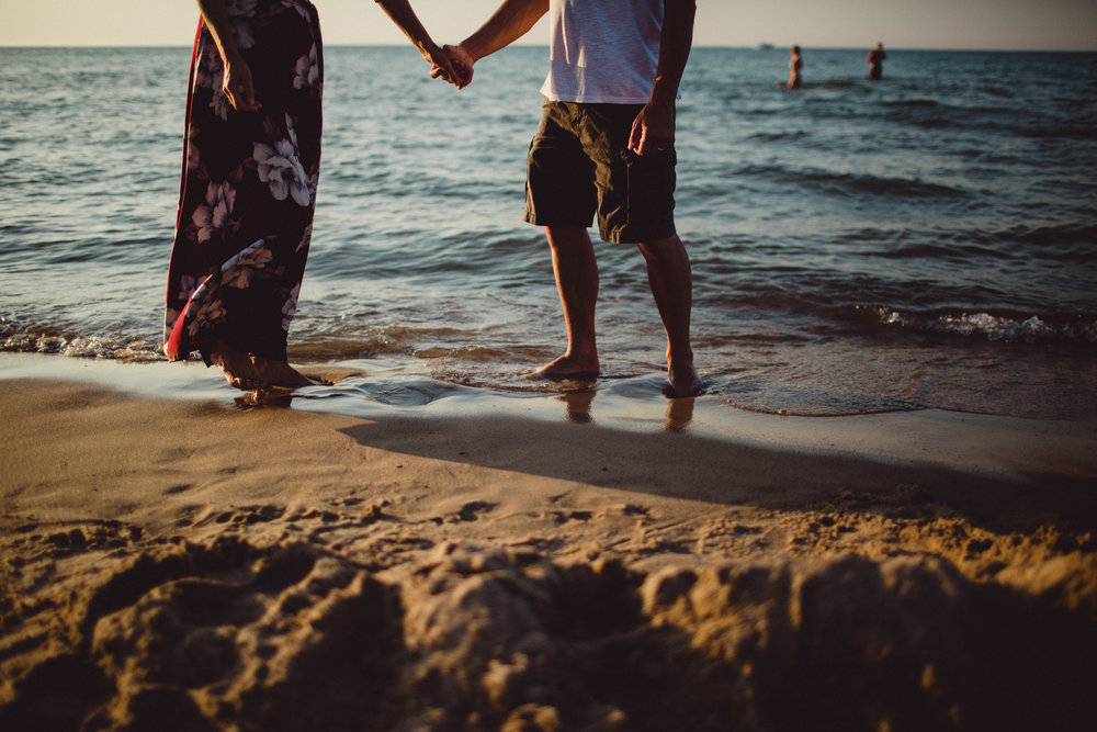 portrait of couple holding hands on the beach