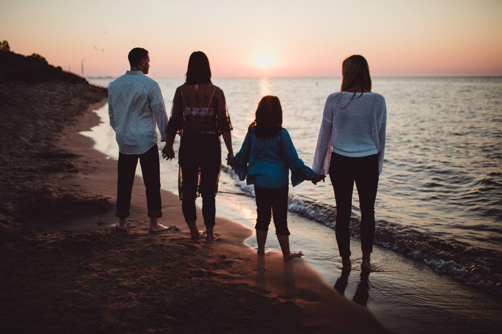 siblings silhouette image on the beach