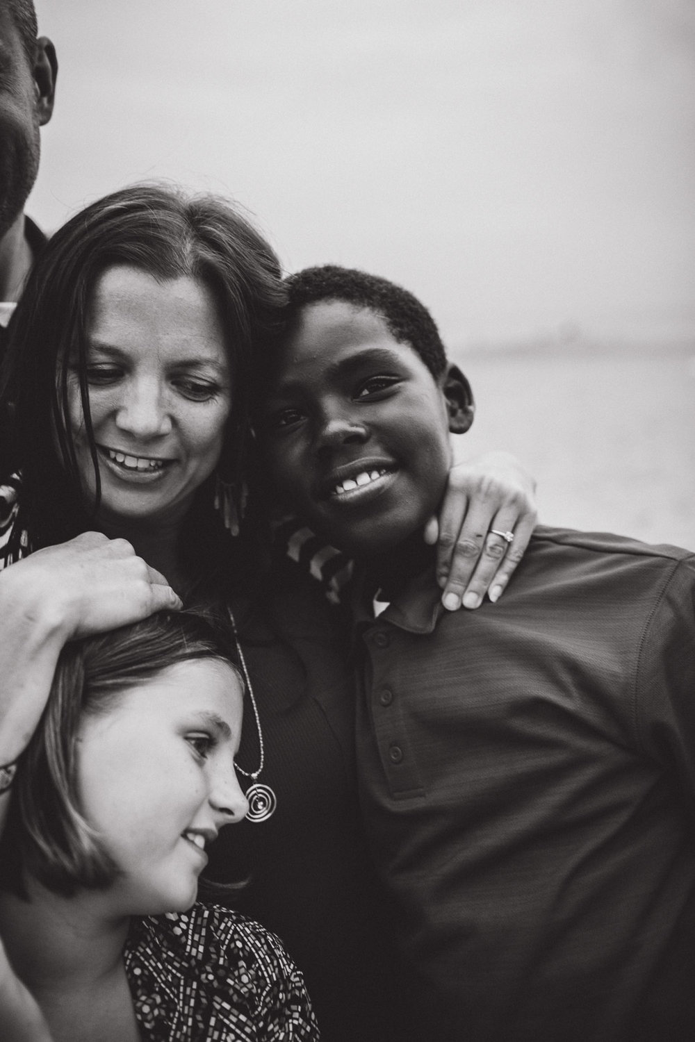 mother loving on children, black and white