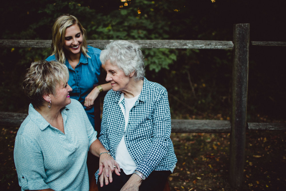 3 women smiling richly a one another