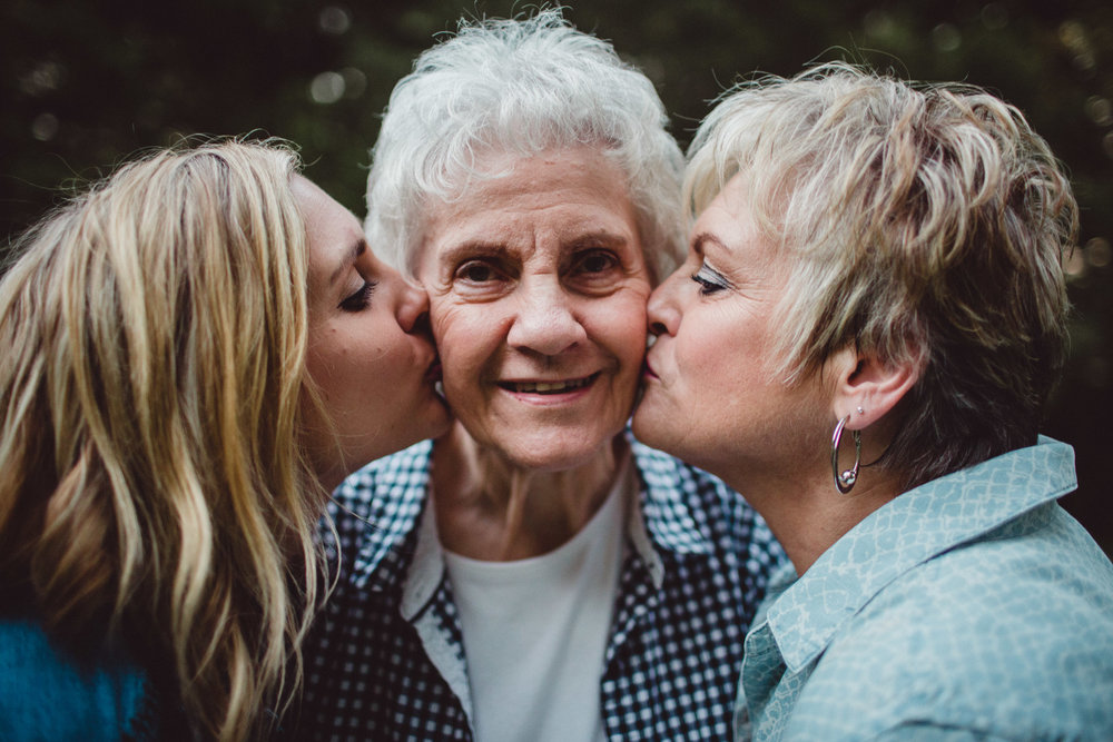 3 generations kissing on the cheek