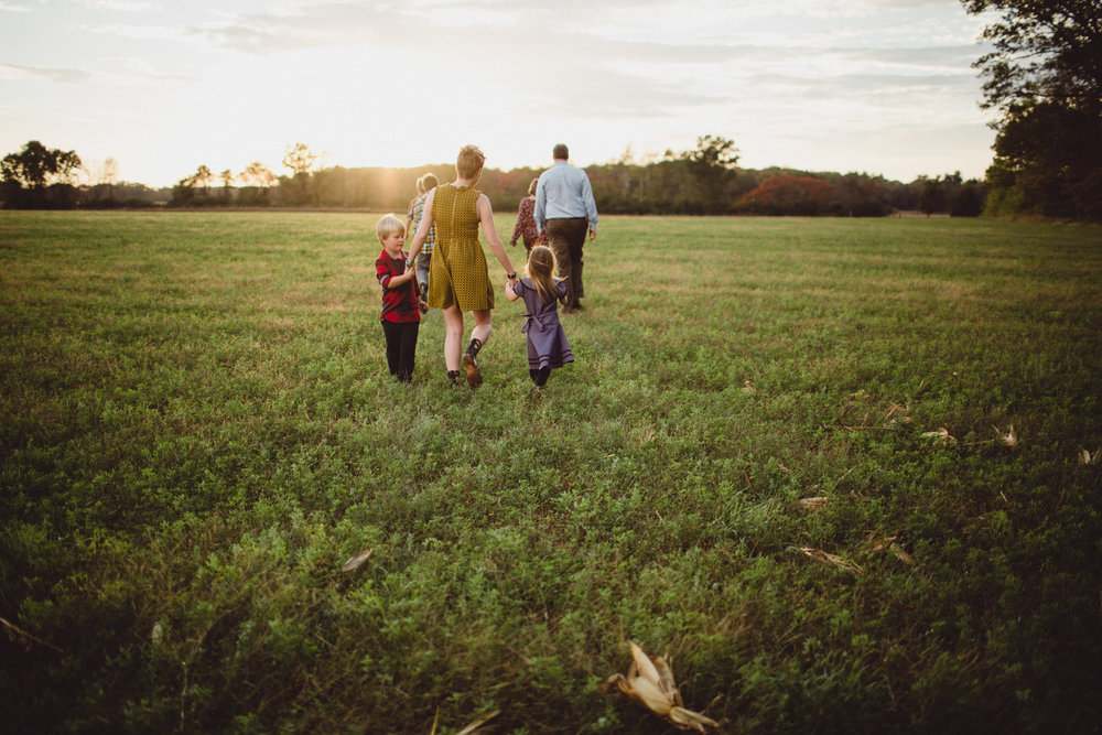 Family walking together into sunset