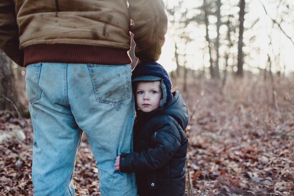 Little Boy Hugging Father's Leg